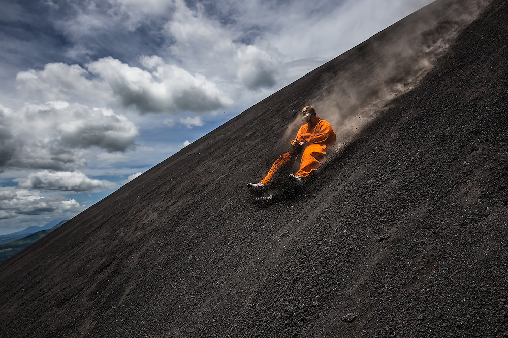 LEON, NICARAGUA - SEPTEMBER 18, 2014:  Jondi Roos, 27, a tourist from Holland volcano boarding down Cerro Negro volcano. The boarders can reach speeds of up to 95 kilometers per hour. Guided tours are available from $29 USD to board down the volcano, located an hour outside of Leon. PHOTO: Meridith Kohut