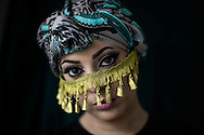 "Hijabistas. Imane Aldebe, 32 years, born in Sweden, living in Stockholm. Designer that makes turbans and owns the brands Happy Turbans and Iman Aldebe Haute. She also created a veil for the Swedish police. She wants to modernize the islamic image of women through fashion. <br /> <br /> ""Fashion can be political and start debates. When it comes to intergration I believe fashion is a more effective way for change than any political labour-market act. I started to modernize the veil when I realized how hard it is to get a job as a Muslim woman in veil. You're not seen as an individual with feelings and thoughts, so I wanted to highlight individuality. It worked. Girls got jobs dressed in my design. Fashion can open many doors."" Iman Aldebe"