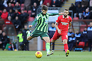 George Francomb of AFC Wimbledon tees up a shot and closely watched by Sammy Moore of Leyton Orient during Sky Bet League 2 match between Leyton Orient and AFC Wimbledon at the Matchroom Stadium, London, England on 28 November 2015. Photo by Stuart Butcher.