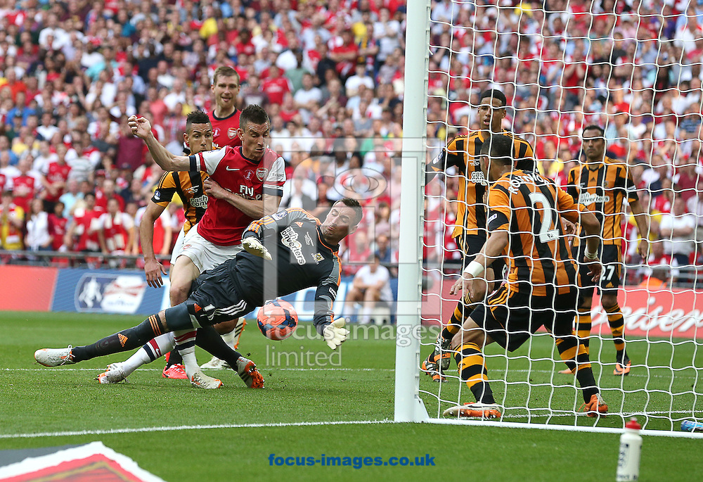 Laurent Koscielny ( 3rd L ) of Arsenal scores to make it 2-2 during the The FA Cup Final match at Wembley Stadium, London<br /> Picture by Paul Terry/Focus Images Ltd +44 7545 642257<br /> 17/05/2014
