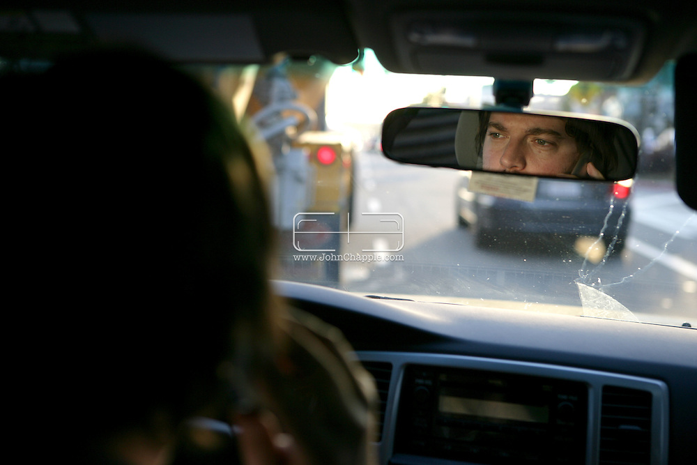 29th January 2008, Los Angeles, California. Paparazzi photographer Alex Turner, who is a staff photographer with one of the largest celebrity news agencies, Splash News. Alex patrols the streets of Los Angeles in his black 4x4 with black windows, on the look-out for celebrities, often receiving tips on his phone. PHOTO © JOHN CHAPPLE / REBEL IMAGES.john@chapple.biz    www.chapple.biz