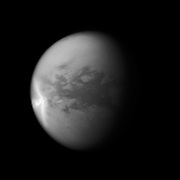 A huge arrow-shaped storm blows across the equatorial region of Titan in this image from NASA's Cassini spacecraft, chronicling the seasonal weather changes on Saturn's largest moon.