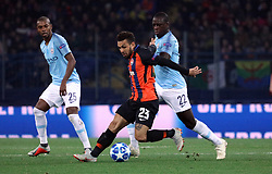 October 23, 2018 - Kharkiv, Ukraine - Midfielder Wellington Nem (C) of FC Shakhtar Donetsk is seen in action with midfielder Fernandinho (L) and defender Benjamin Mendy of Manchester City FC during the UEFA Champions League Group F Matchday 3 game at the Metalist Stadium Regional Sports Complex, Kharkiv, northeastern Ukraine, October 23, 2018. Ukrinform. (Credit Image: © Danil Shamkin/Ukrinform via ZUMA Wire)