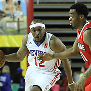 Delaware 87ers Guard Josh Akognon (12) drives by Maine Red Claws Guard Tyler Brown (11) in the first half of a NBA D-league regular season basketball game between the Delaware 87ers (76ers) and the Maine Red Claws (Boston Celtics) Friday, March. 21, 2014 at The Bob Carpenter Sports Convocation Center in Newark, DEL