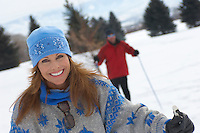 Portrait of smiling mature woman cross country skiing