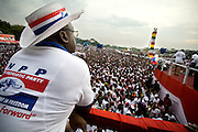 A member of the New Patriotic Party (NPP) looks over a large crowd of supporters during a campaign rally in Ghana's capital Accra on Friday December 5, 2008. Thousands of Ghanaians gathered in final rallies as they prepared to head to the polls on Sunday December 7 to elect a new government.