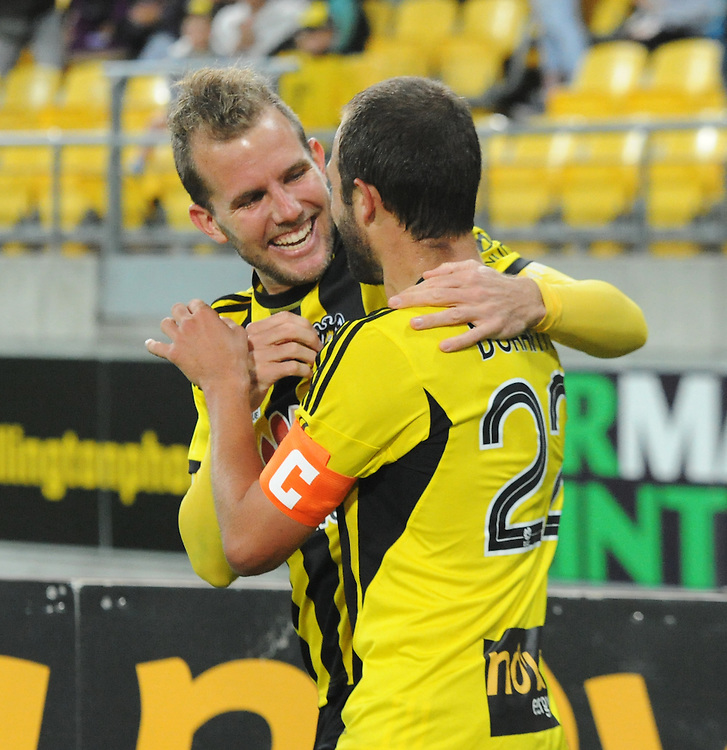 Phoenix's Jeremy Brockie, left, celebrates with his captain Andrew Durante after scoring against the Melbourne Victory FC in the A-League football match at Westpac Stadium, Wellington, New Zealand, Saturday, Januray 18, 2014. Credit:SNPA / Ross Setford