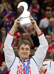 Momir Ilic  of Serbia and his Second placed team of Serbia celebrate at closing ceremony after the final handball match between Serbia and Denmark at 10th EHF European Handball Championship Serbia 2012, on January 29, 2012 in Beogradska Arena, Belgrade, Serbia. Denmark defeated Serbia 21-19 and became European Champion 2012. (Photo By Vid Ponikvar / Sportida.com)