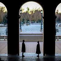 Standing couple, Plaza de España, Seville, Spain.