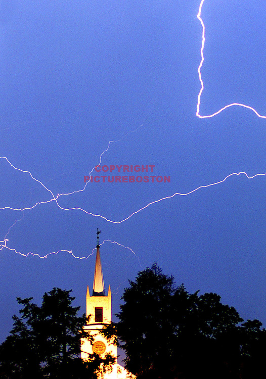 Lightning wreaked havoc on North Shore towns such as Hamilton Today and Tonite in two seperate Thunderstorm outbreaks July24'99..Here lightning strikes above Hamilton's First Congregational Church on Bay Road.Mark Garfinkel photo