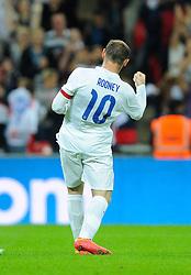 England captain, Wayne Rooney (Manchester United) celebrates - Photo mandatory by-line: Joe Meredith/JMP - Mobile: 07966 386802 - 3/09/14 - SPORT - FOOTBALL - London - Wembley Stadium - England v Norway - International Friendly