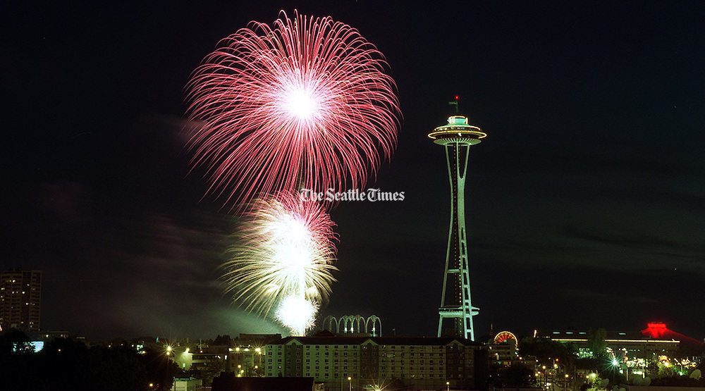 The Ivar's Fourth of July fireworks behind the Space Needle on July 4, 1997.<br /> Bruce McKim / The Seattle Times
