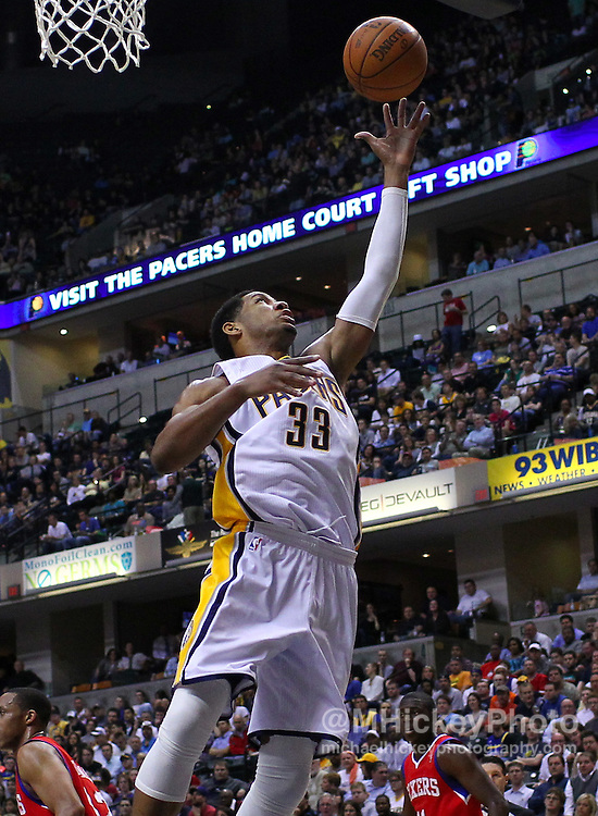 March 14, 2012; Indianapolis, IN, USA; Indiana Pacers small forward Danny Granger (33) reaches for a rebound against the Philadelphia 76ers at Bankers Life Fieldhouse. Mandatory credit: Michael Hickey-US PRESSWIRE