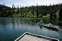 JEROME A. POLLOS/Press..Mike Wolf takes his small fishing boat out from the dock at Fernan Lake motoring past property Friday that was deeded to the City of Coeur d'Alene. The 50 acres on the south side of Fernan Lake was set aside to be a waterfront walking area like Tubbs Hill.
