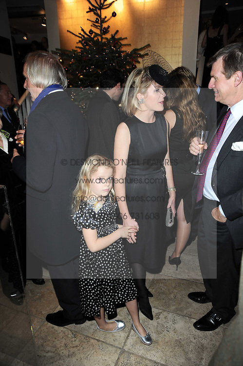 VISCOUNTESS LINLEY and her daughter the HON.MARGARITA ARMSTRONG-JONES at the Linley Christmas Party and launch of the book 'Star Pieces' by David Linley, Charles Cator and Helen Chislett held at Linley, 60 Pimlico Road, London on 18th November 2009.