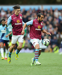 Aston Villa's Jack Grealish and Aston Villa's Kieran Richardson go for the same ball  - Photo mandatory by-line: Joe Meredith/JMP - Mobile: 07966 386802 - 09/05/2015 - SPORT - Football - Birmingham - Villa Park - Aston Villa v West Ham United - Barclays Premier League