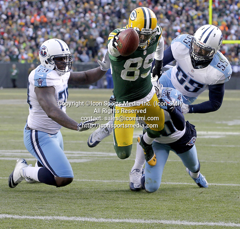 Dec. 23, 2012 - Green Bay, WI, USA - Green Bay Packers James Jones stretches to score a touchdown on a reception during the third quarter at Lambeau Field on Sunday, December 23, 2012, in Green Bay, Wisconsin. The Green Bay Packers defeated the Tennessee Titans, 55-7.