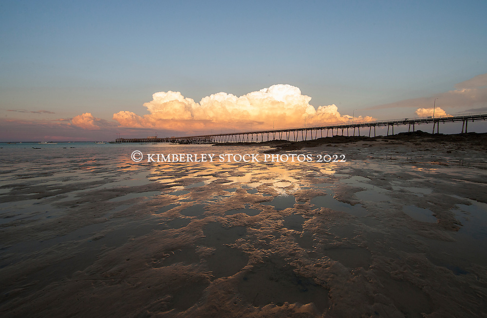 Extensive mudbanks are revealed at low tide near the Broome jetty.