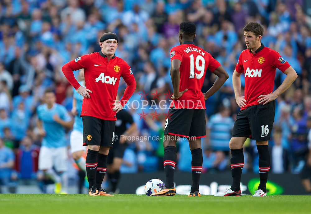 MANCHESTER, ENGLAND - Sunday, September 22, 2013: Manchester United's Wayne Rooney looks dejected as Manchester City score the third goal during the Premiership match at the City of Manchester Stadium. (Pic by David Rawcliffe/Propaganda)