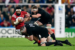 Vili Ma'afu of Tonga is tackled by Brodie Retallick and Kieran Read of New Zealand - Mandatory byline: Patrick Khachfe/JMP - 07966 386802 - 09/10/2015 - RUGBY UNION - St James' Park - Newcastle, England - New Zealand v Tonga - Rugby World Cup 2015 Pool C.