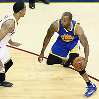 10 June 2016: Cleveland Cavaliers forward Channing Frye (9) defends on Golden State Warriors forward Andre Iguodala (9) during the Golden State Warriors 108-97 victory over the Cleveland Cavaliers, during Game Four of the 2016 NBA Finals at the Quicken Loans Arena, Cleveland, Ohio, USA.