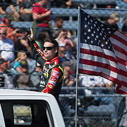 October 27, 2013:  Sprint Cup Series driver Jeff Gordon (24) waves to the crowd with the American flag behind him after driver introductions during the Sprint Cup Series Goody's Headache Relief Shot 500 at Martinsville Speedway, Martinsville, VA. (Credit Image: © Kostas Lymperopoulos/Cal Sport Media)