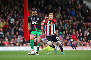 Brentford midfielder, Ryan Woods (15) battling for ball with Bristol City midfielder, Marlon Pack (21) during the Sky Bet Championship match between Brentford and Bristol City at Griffin Park, London, England on 16 April 2016. Photo by Matthew Redman.
