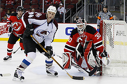 Feb 26, 2009; Newark, NJ, USA; Colorado Avalanche left wing Ryan Smyth (94) and New Jersey Devils goalie Martin Brodeur (30) watch the puck during the third period at the Prudential Center. The Devils defeated the Avalanche 4-0.