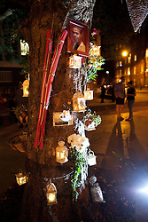 © Licensed to London News Pictures . 21/08/2012 . London , UK . A candle lit memorial to Sean Rigg placed around a tree outside Brixton Police Station . Protesters march from Lambeth Town Hall to Brixton police station to demonstrate against deaths in police custody . Relatives of Sean Rigg , who died in police custody in August 2008 , lead the march . Video has emerged of a man being detained in Brixton on Sunday ( 19th August ) during which it is alleged police officers stamped on his head . Protesters delivered a formal complaint about the incident to the counter of Brixton Police Station , following the march . Photo credit : Joel Goodman/LNP