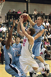 08 February 2014:  Will Nixon, Michael Mayberger & Taylor Baxter during an NCAA mens division 3 CCIW basketball game between the Elmhurst Bluejays and the Illinois Wesleyan Titans in Shirk Center, Bloomington IL