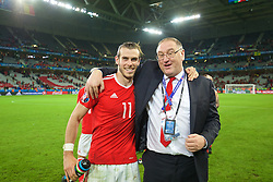 LILLE, FRANCE - Friday, July 1, 2016: Wales' Gareth Bale and Martin Hodge celebrates after a 3-1 victory over Belgium and reaching the Semi-Final during the UEFA Euro 2016 Championship Quarter-Final match at the Stade Pierre Mauroy. (Pic by David Rawcliffe/Propaganda)