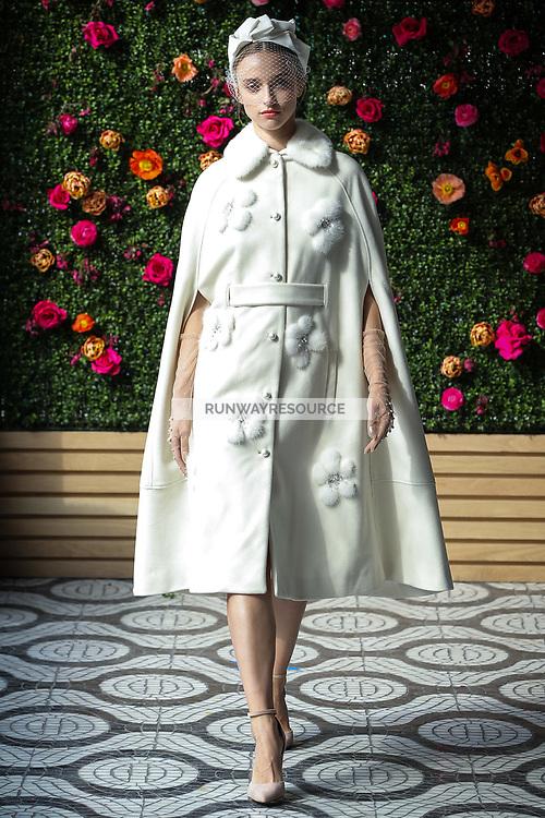 A model walks the runway wearing Lela Rose Bridal Spring 2018