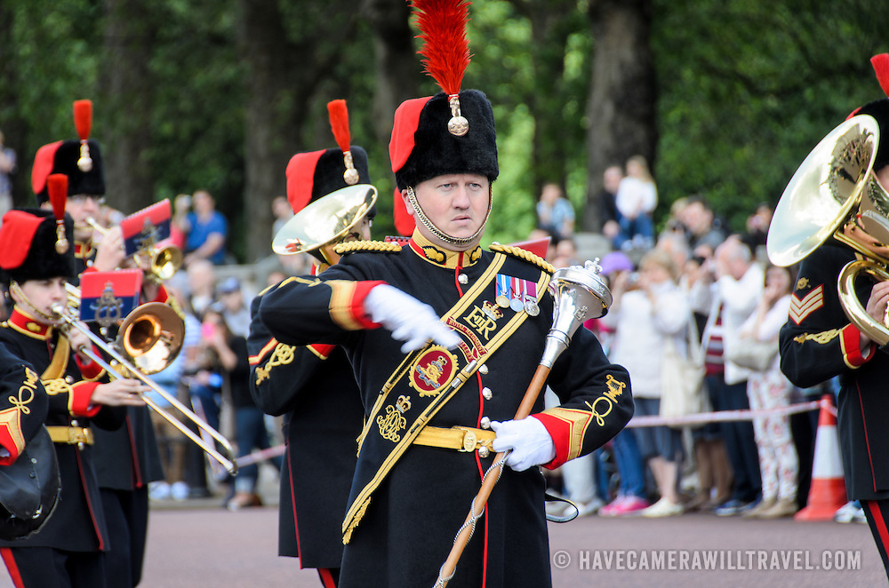 Marching Band at the Changing of the Guard 169-110950716x The band leader in front of a maching band as part of the Changing of the Queen's Guard ceremony at Buckingham Palace in London.