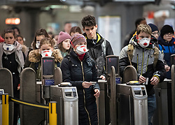 © Licensed to London News Pictures. 09/03/2020. London, UK. A group of people wearing medical masks at Westminster Underground station in central London. New cases of the COVID-19 strain of Coronavirus are being reported daily as the government outlines it's plans for controlling the outbreak. Photo credit: Ben Cawthra/LNP