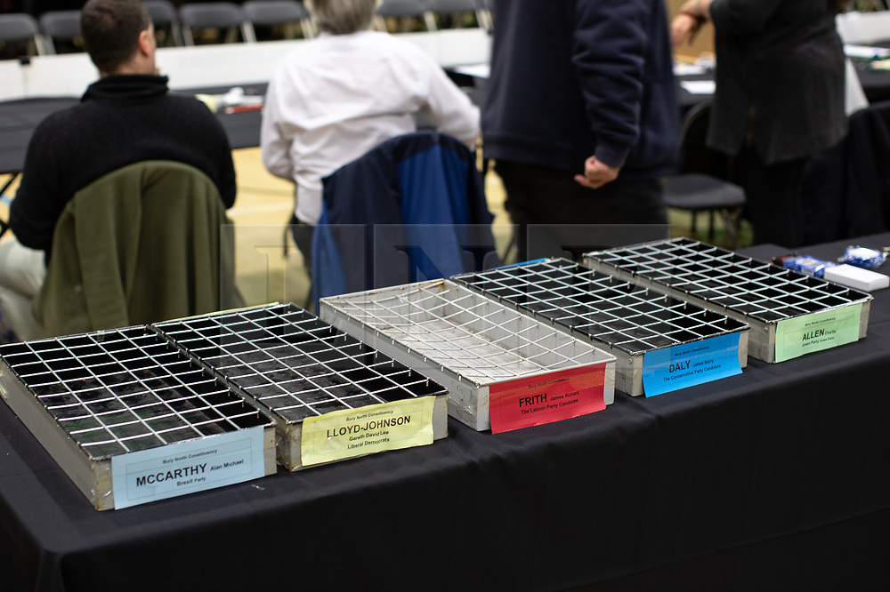 © Licensed to London News Pictures . 12/12/2019. Bury, UK. Trays laid out for ballots in the Bury North constituency . Final preparations are made at the the count for seats in the constituencies of Bury North and Bury South in the 2019 UK General Election , at Castle Leisure Centre in Bury . Photo credit: Joel Goodman/LNP