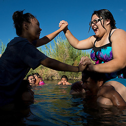 Surita Hernandez brings her children along with neighbors to swim in a river on the Moapa reservation outside Las Vegas, Nevada in July, 2012. They don't get to go outside as often as they like because of the poor air quality. In the photos are: Ayona Hernandez, (wearing glasses on right)13, Aaliya Hernandez , 16, (grey shirt on left )Gyiel Hernandez, 7, (Small boy)  Surita Hernandez, (mother) 37, Zayda Hernandez, (black shirt) 14,  Edgar Perez, 16, Summer Marie Sunshine Nickrand, 14  and Ayasha Hernandez, 4 and on the Moapa reservation in Nevada. All of their family suffers from Asthma and though they can't prove it, believe its because of the coal plant next door. Her grandfather died in march because of cancer. The Sierra Club is working with the Moapa Band of Paiutes to transition NV Energy away from the Reid Gardner coal-fired power plant -- which sits only 45 miles from Las Vegas and a short walk from community housing at the Moapa River Indian Reservation. The Reid Gardner coal plant is literally spewing out tons of airborne pollutants such as mercury, nitrous oxide, sulfur dioxide, and greenhouse gases. This has resulted in substantial health impacts on the Moapa community, with a majority of tribal members reporting a sinus or respiratory ailment. Vernon Lee believes that the many people on the Moapa reservation suffering from health issues are because of the coal plant next door. Sierra Club is working with the Moapa Band of Paiutes to transition NV Energy away from the Reid Gardner coal-fired power plant -- which sits only 45 miles from Las Vegas and a short walk from community housing at the Moapa River Indian Reservation. The Reid Gardner coal plant is literally spewing out tons of airborne pollutants such as mercury, nitrous oxide, sulfur dioxide, and greenhouse gases. This has resulted in substantial health impacts on the Moapa community, with a majority of tribal members reporting a sinus or respiratory ailment.