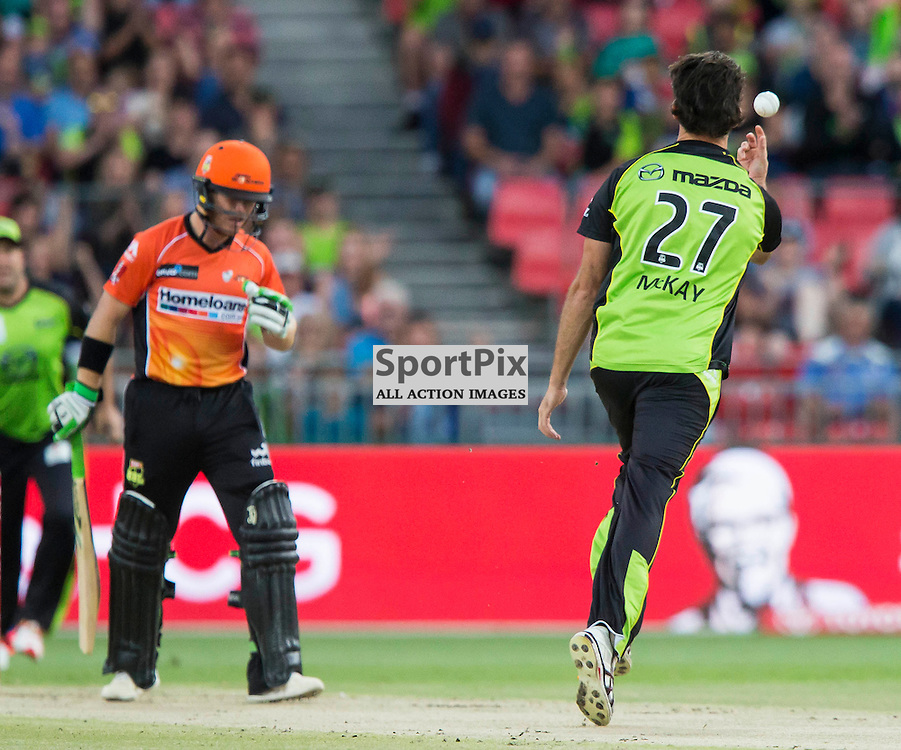 KFC Big Bash League T20 2015-16 , Sydney Thunder v Perth Scorchers, Spotless Stadium; 7 January 2016<br /> Perth Scorchers Marcus Harris walks off as Sydney Thunder Clint McKay takes a catch from his own bowling.