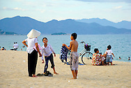 Vietnamese families enjoy a late afternoon at the beach in Nha Trang, a scenic town popular with both locals and foreign visitors. Its bay has been listed among the most beautiful in the world by publications such as Travel and Leisure. (Nha Trang, Vietnam - July 6, 2007)