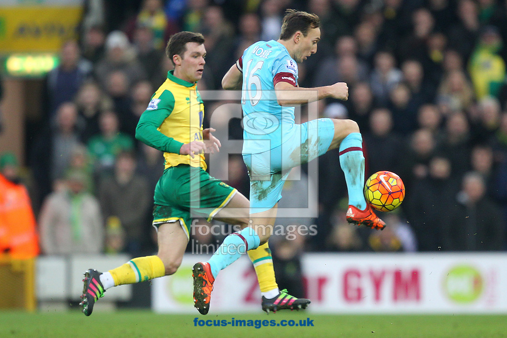 Mark Noble of West Ham and Jonny Howson of Norwich in action during the Barclays Premier League match at Carrow Road, Norwich<br /> Picture by Paul Chesterton/Focus Images Ltd +44 7904 640267<br /> 13/02/2016