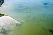 Nederland, Friesland, Gemeente Dongeradeel, 05-08-2014; <br /> Wierumerwad onderdeel van het Friesche Wad. Kweldergebied met landaanwinning door middel van zogenaamde  kwelderwerken: vakken begrenst door rijshouten golfbrekers die als gevolg hebben dat het slib kan bezinken. Als de kwelders hoog genoeg groeien er er kwelderplanten <br /> Land reclamation, salt marsh area outside the dikes. The so-called salt marsh works consist of square sections, bordered by brushwood breakwaters causing the sludge to settle.<br /> luchtfoto (toeslag); aerial photo (additional fee required); foto Siebe Swart / photo Siebe Swart