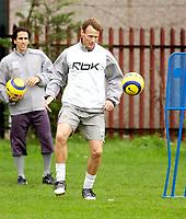 Photo: Daniel Hambury.<br />West Ham Utd Training. 03/11/2005.<br />Teddy Sheringham (R) passes the ball as Yossi Benauyoun looks on.