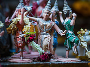31 DECEMBER 2015 - BANGKOK, THAILAND: Small traditional Thai figurines in a shrine in Bang Chak Market. The market is supposed to close permanently on Dec 31, 2015. The Bang Chak Market serves the community around Sois 91-97 on Sukhumvit Road in the Bangkok suburbs. About half of the market has been torn down. Bangkok city authorities put up notices in late November that the market would be closed by January 1, 2016 and redevelopment would start shortly after that. Market vendors said condominiums are being built on the land.          PHOTO BY JACK KURTZ