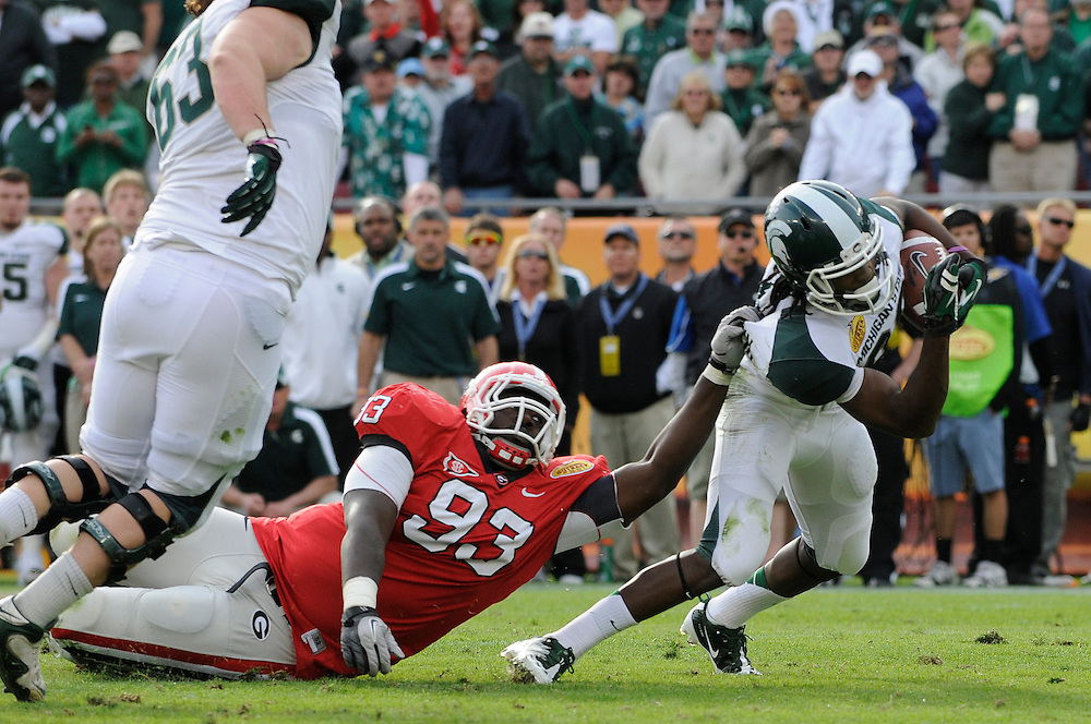 January 2, 2012: Keshawn Martin of Michigan State is tackled by Abry Jones of Georgia during the NCAA football game between the Michigan State Spartans and the Georgia Bulldogs at the 2012 Outback Bowl at Raymond James Stadium in Tampa, Florida. The Spartans defeated the Bulldogs 33-30.
