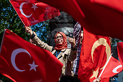 © Licensed to London News Pictures. 15/05/2018. London, UK. Supporters of Recep Tayyip Erdogan gather opposite Downing Street ahead of the Turkish President's arrival to Downing Street. President Erdogan will meet with British Prime Minister Theresa May later today. Photo credit: Rob Pinney/LNP