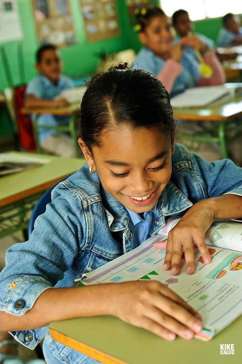 Dominican children learning in a classroom in Abreu, next to Playa Grande, 120 km east of Puerto Plata.