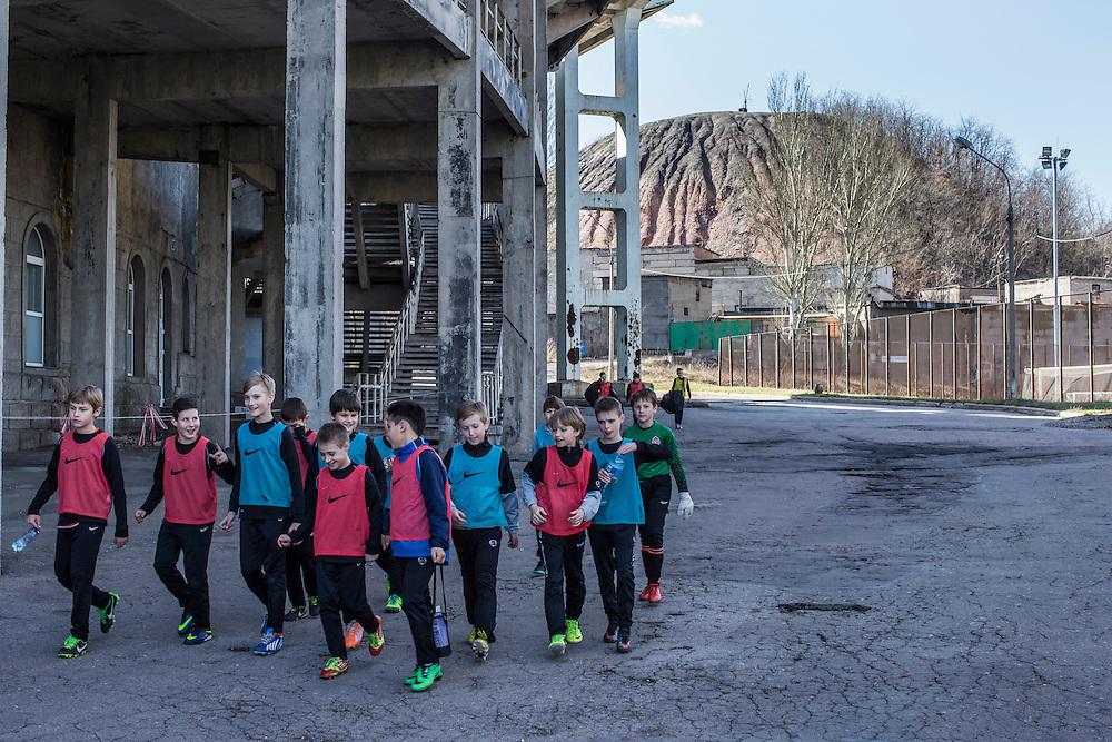 Children arrive for soccer practice on Friday, April 10, 2015 in Donetsk, Ukraine.
