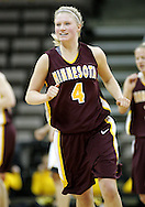 25 JANUARY 2007: Minnesota guard Emily Fox (4) smiles after hitting a three pointer in Iowa's 80-78 overtime loss to Minnesota at Carver-Hawkeye Arena in Iowa City, Iowa on January 25, 2007.