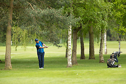 © Licensed to London News Pictures. 13/05/2020. Coventry, Warwickshire, UK. Golf return. The first golfers back on the course this morning after restrictions were relaxed to allow golf to be played again after the virus outbreak. The scene is the first hole at Maxstoke Park golf club in Warwickshire. Players had to keep their distance from each other, were not allowed to touch the flags or use the ball washers. Photo credit: Dave Warren / LNP