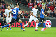 England's Theo Walcott on the ball during the UEFA European 2016 Qualifier match between England and Estonia at Wembley Stadium, London, England on 9 October 2015. Photo by Shane Healey.