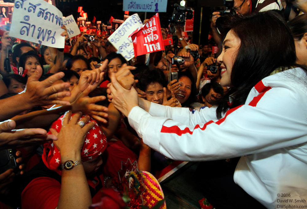 Yingluck Shinawatra, sister of deposed and exiled former president Thaksin Shinawatra meets and greets red shirts during a Pheu Thai party campaign stop in Chiang Mai, Thailand.